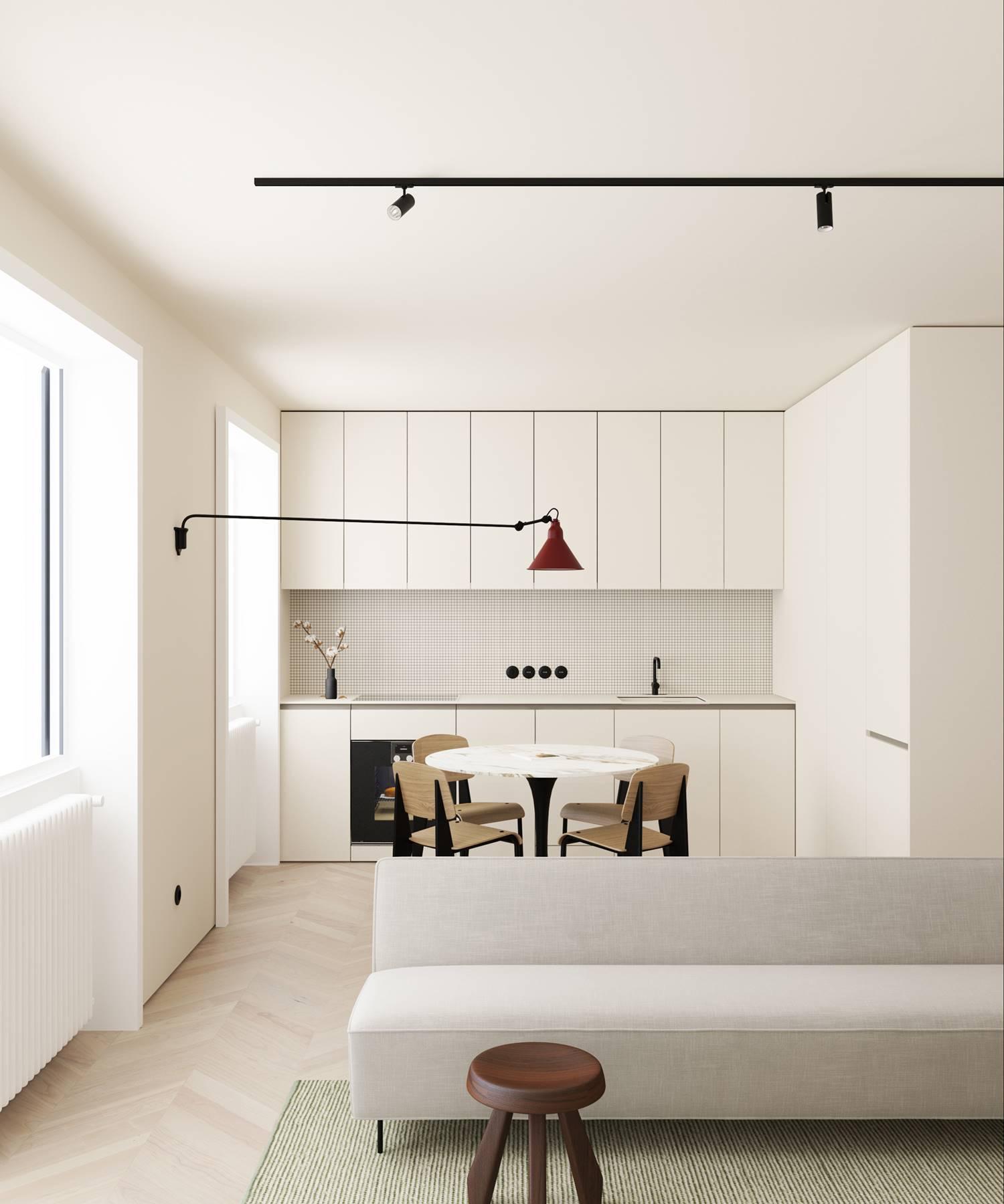 Interior decorado en blanco con pequeños detalles de color.
