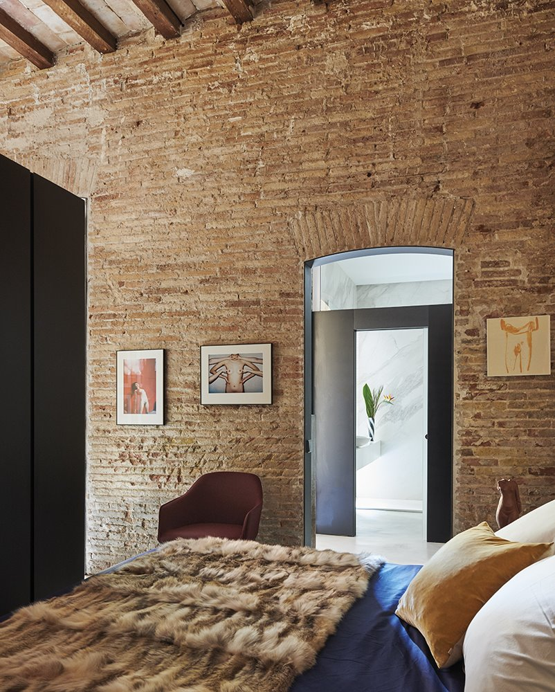 casa rardo architects dormitorio pared de ladrillo