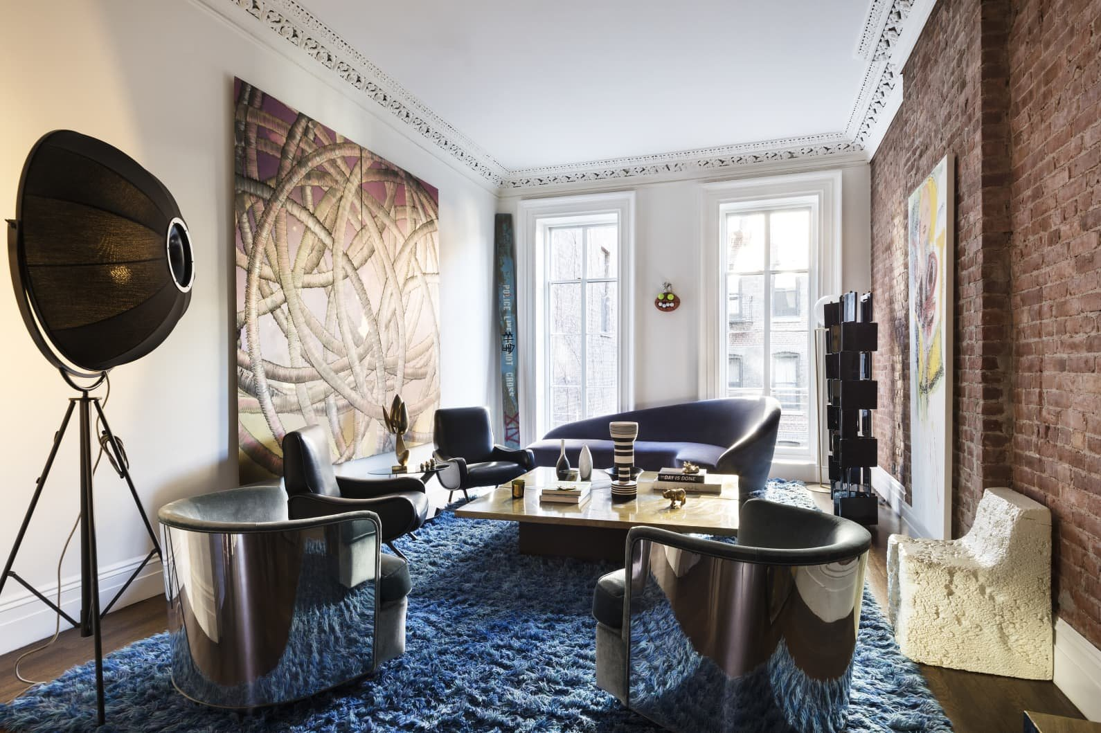 Apartamento Mary Kate Oslen en Manhattan estar con lampara de Fortuny