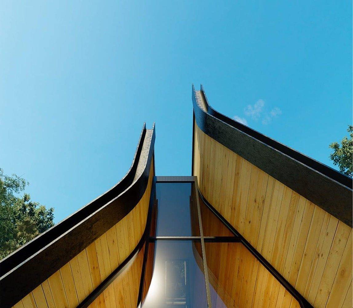 En lugar de encontrarse en el vértice superior, los lados de la cubierta discurren en paralelo en su parte más alta para generar una claraboya cenital.