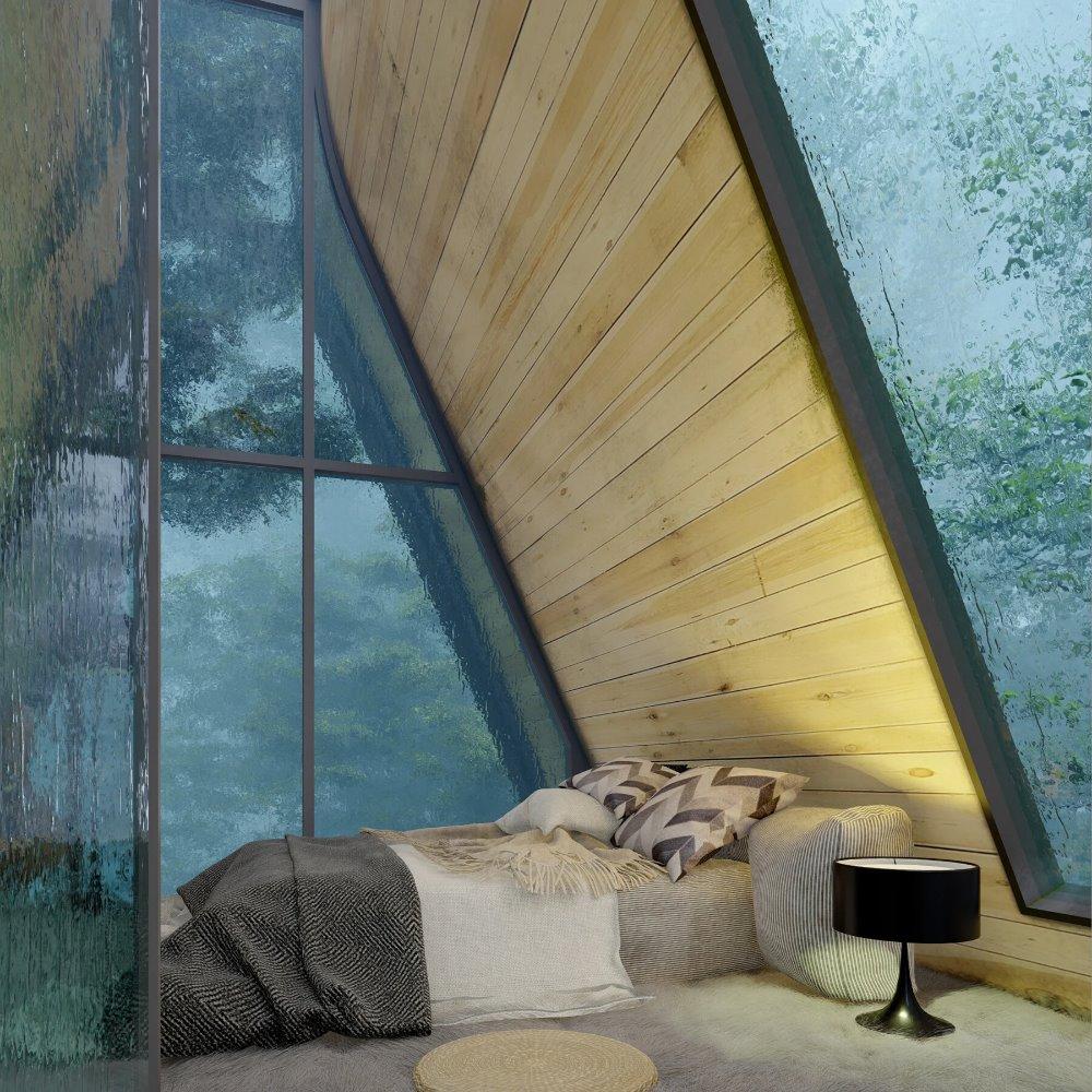 La altura holgada de la cabaña permite ubicar el dormitorio en el nivel superior, justo bajo la cubierta.